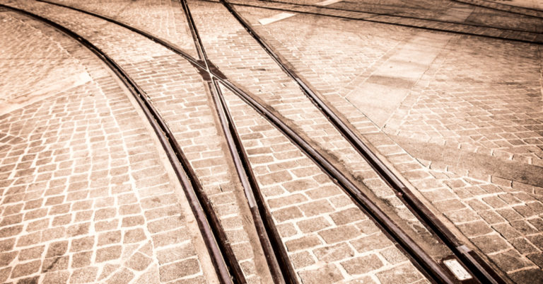 Contract breach represented by train tracks diverging