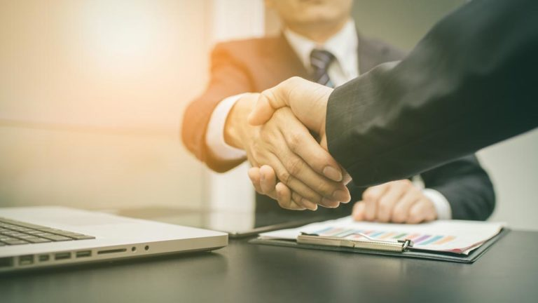 Embrace contract management symbolized by shaking hands