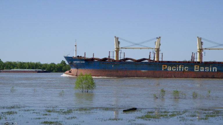 City of Kenner river with barge