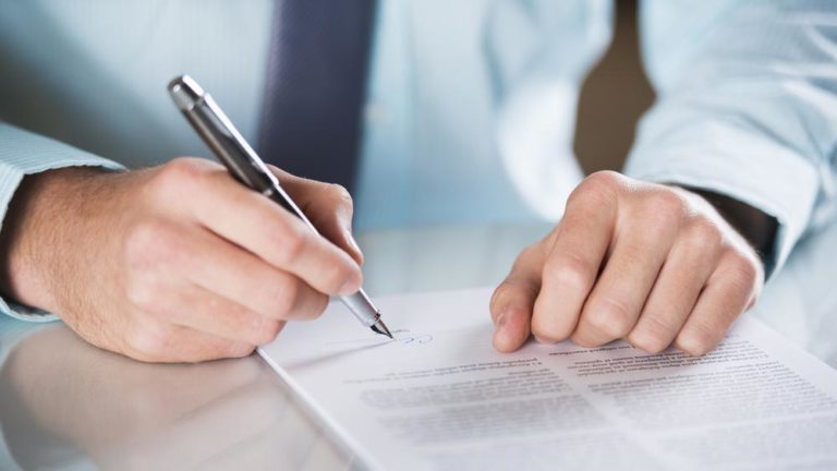 Procurement frontier man signing contract on paper