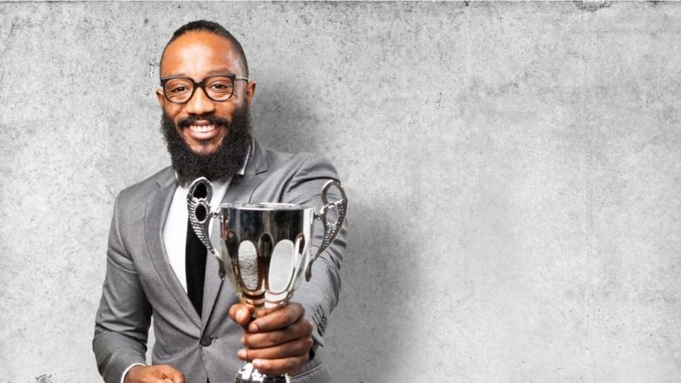 Successful contract management with man holding trophy