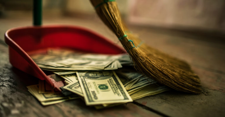 Saving money on contract processes represented by broom sweeping up money