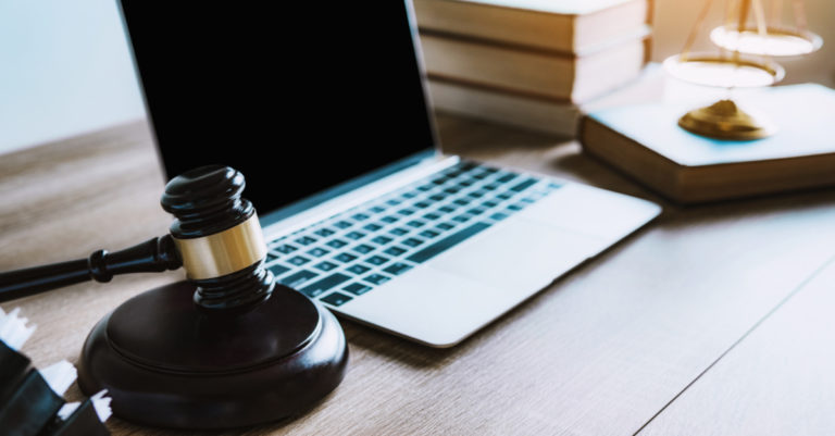 3 guidelines for legal tech buyers represented by a gavel and laptop