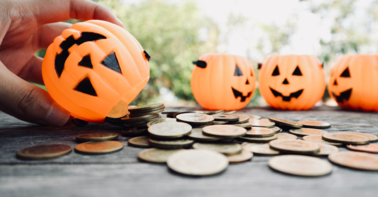 Pumpkins with coins representing money saved with a contract management platform
