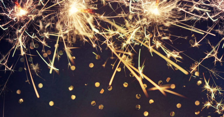 New year contract processes represented by fireworks and glitter over a black background