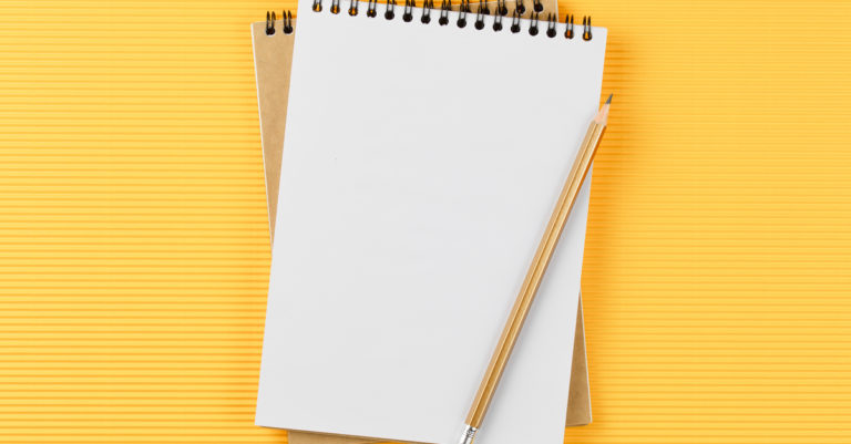 Best practices worksheet for getting started with contract management represented by notebook and pen