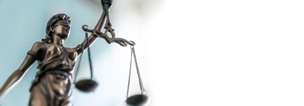 Lady Justice balancing scales